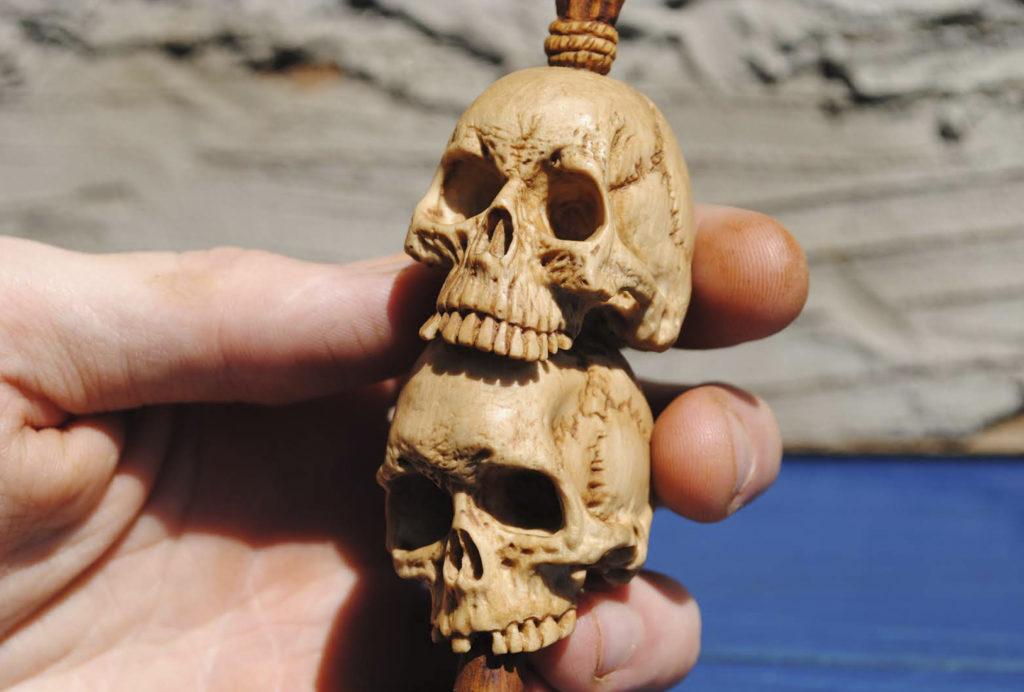 Skull pipe tamper